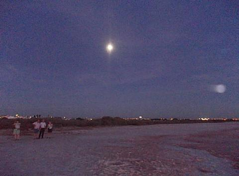 Sunset over the salt lake in San Luis