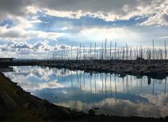 Nuages et soleil sur le port du Havre