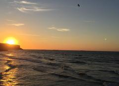 Mer Arromanches-les-Bains 14117 Le soleil se couche au bord de mer