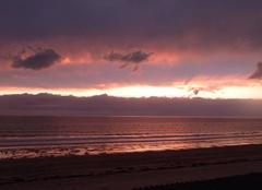 Ciel Jullouville 50610 Ciel rose sur la mer