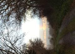 Pluie Montmorin 63160 Arc en ciel sur Église neuve